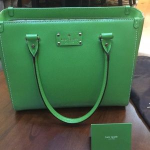 Apple green Kate Spade purse with dust cover